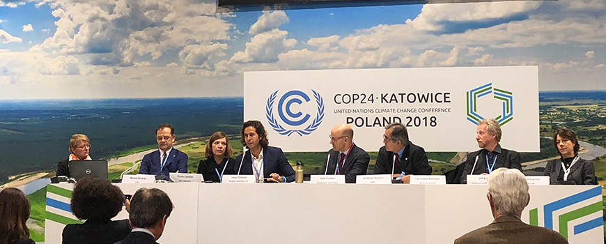 Scripps postdoctoral researcher Yassir Eddebbar (center) speaks at a panel discussion at COP24 climate talks in Katowice, Poland