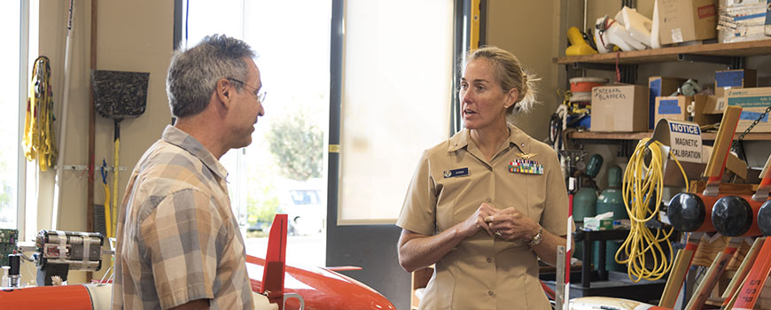 Scripps scientist Dan Rudnick leads Rear Admiral Nancy Hann on a tour of the Underwater Glider Laboratory at Scripps.