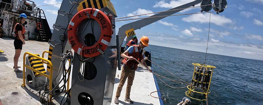 Students retrieve a CTD unit at the fantail of research vessel Robert Gordon Sproul June 1.