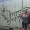 April Stabbins and Lily Simons with unicorn shrimp mural