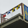 "Signal flags spelling ""Spiess Hall"" fly from the railing of the building newly named for Fred Spiess. (Jan. 23, 2009)"